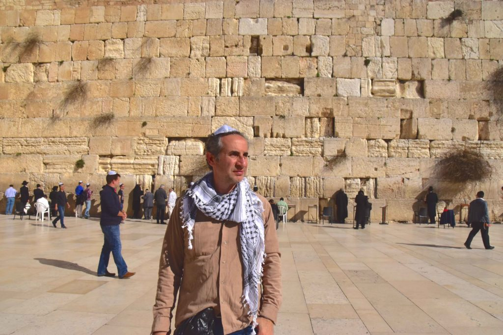 Me at the Western Wall in Jerusalem, wearing the Jewish yamaka and the Arabic turban.